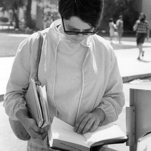 Female student browsing books