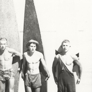 Rich Thompson, Harry Mayo, Bob Gillies in front of surfboards at Cowell ...