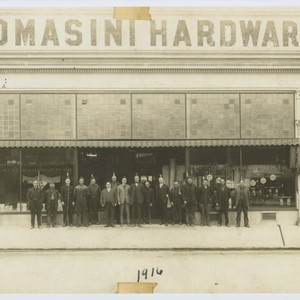Group of employees standing outside of the A. F. Tomasini Hardware stores ...