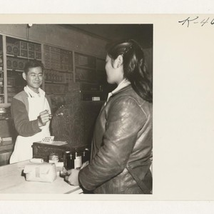 Shig Nishimoto rings up a sale in his newly opened general merchandise ...
