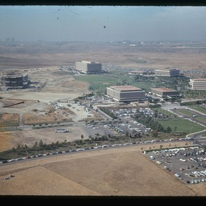 Aerial view of buildings and construction sites on campus, ca. 1970