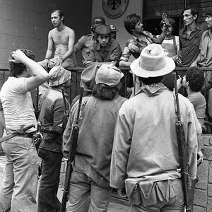 Sandinistas gather outside of a building, Nicaragua, 1979