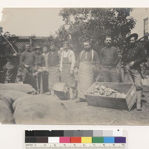 [Soldiers and butchers with meat provisions. Unidentified location.]