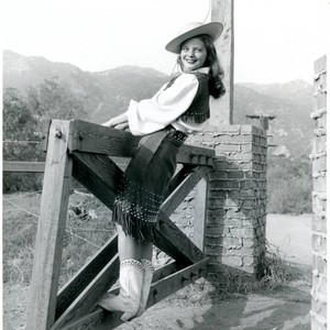 Publicity Photo of a cowgirl on a gate for the Malibu Remuda, ...