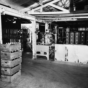 Interior of the Utt Juice Company, Tustin, showing boxes of bottles waiting ...