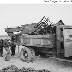 Men loading a City of Coronado truck with wreckage from the gambling ...