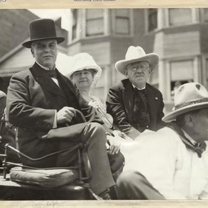 [Mayor and Mrs. Rolph riding in a carriage]