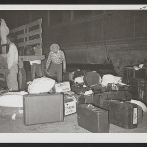 Unloading hand baggage at Casa Grande railhead. Rivers, Arizona