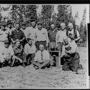 Occidental men at deer hunting camp