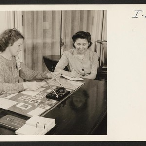 Miss Mary Saito, formerly of Granada and Los Angeles, takes dictation as ...