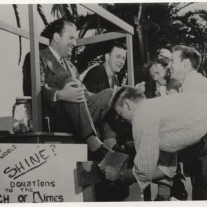 President Hugh M. Tiner at March of Dimes shoe-shine fundraiser, circa 1950