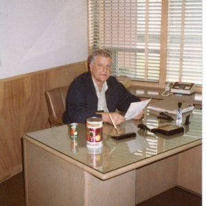 Donald O. Hallberg sitting at his desk at the office of O. ...