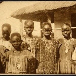 Young girls gathered outdoors on their day of baptism, Congo, ca.1920-1940