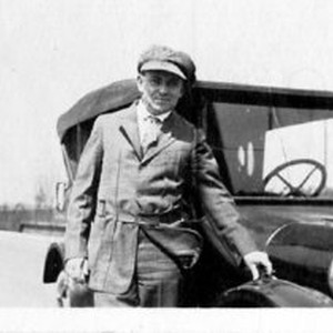Man standing next to automobile