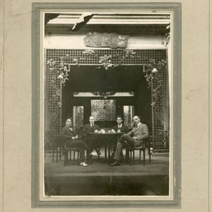 Men having tea in an arcade area, with Roy Maxwell Talbot included
