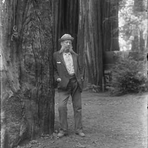 Man with glasses, long white sideburns and flower tie, Bohemian Grove. [negative]