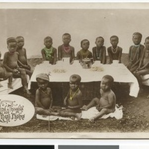 African children sitting around a coffee table, South Africa
