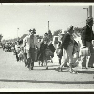 Internees walking to trains in Stockton, California