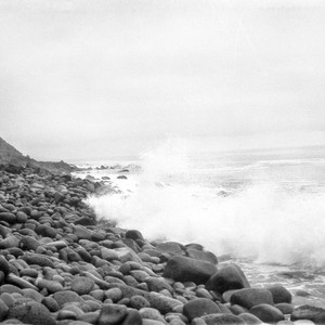 Waves on basalt cobbles (three feet long) at Colnett Bay with conglomerate ...