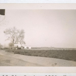 Spring, 1936, Kern County. [Distant view of public toilets shown in picture ...