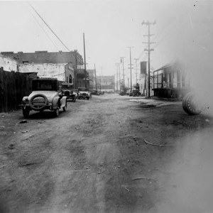 Olvera Street looking north, Avial Adobe on right, old cars parked on ...