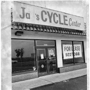 "Jay's Cycle Center store with ""closed"" and ""for lease"" signs"