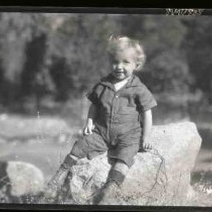 Child sitting on a rock
