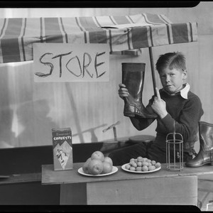 Boy playing store, Los Angeles, circa 1935