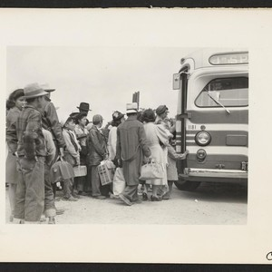 The bus has just arrived and these farm families of Japanese ancestry ...