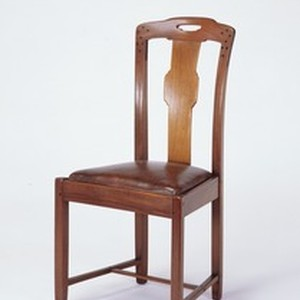 Side chair of Honduras mahogany and ebony with leather seat
