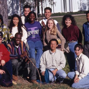 A diverse group of students posing for a photo, standing in front ...