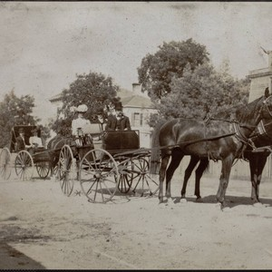 Unidentified passengers in horse drawn carriages, Sixth Street, Petaluma, California, between 1890 ...