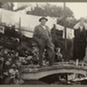 [Alfred Fuhrman with man and woman standing on small landscape bridge in ...