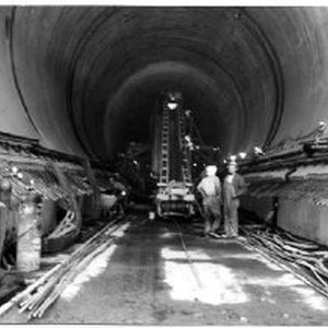 Workers lay concrete in the number two diversion tunnel at the Oroville ...