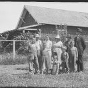A family standing in front of a building