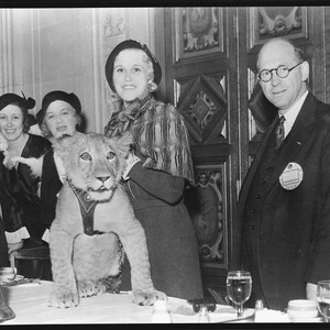 Peggy Hamilton, standing next to Ethel and Grace Bush, holds a lion ...