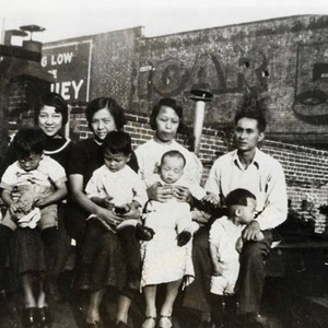 Howard Quon family sitting on a roof on Sanchez Street; pictures three ...