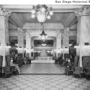 People seated in chairs in the lobby of the US Grant Hotel