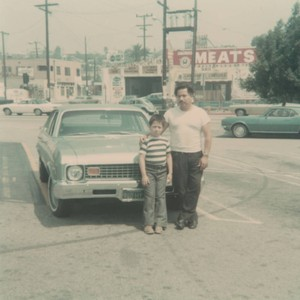 Father and son, parking lot, East Los Angeles, California