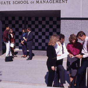 Ex MBA students standing in front of the Graduate School of Management ...