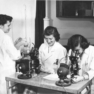 Researchers with microscopes in Laboratory of Experimental Oncology