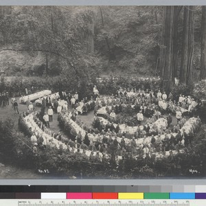 Bird's-eye view of members seated at tables in dining area, Bohemian Grove. ...