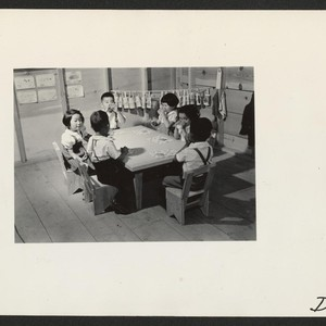 Milk and cracker time in the nursery school. Photographer: Stewart, Francis Newell, ...