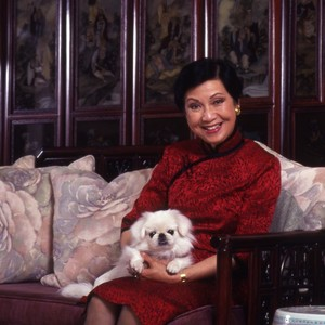 Mrs. Cheng with dog.