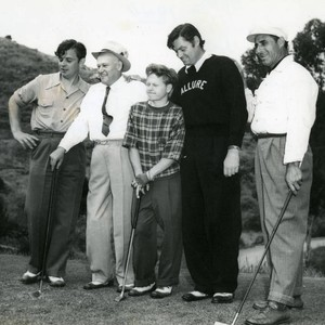 Golfers, including Mickey Rooney and Johnny Weissmuller, at the Bobby Jones Invitational ...