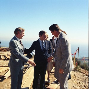 Jerry Hudson greets Ronald Reagan during Pepperdine University tree planting dedication, 1973