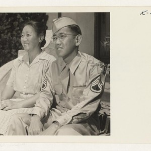 Mrs. Jinzo Kato, recently returned from Topaz, is shown with her hero ...