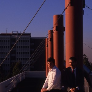 Two unidentified faculty members (Samuelson?) posing on a roof top. Engineering tower ...