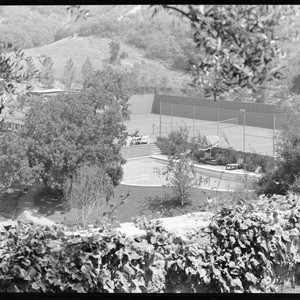 Loy, Myrna, and Arthur Hornblow, residence. Tennis court and Swimming pool
