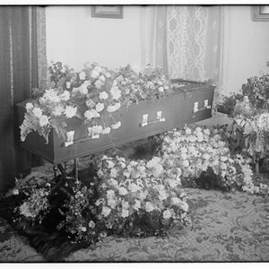 Coffin with floral arrangement, Merced Falls, Merced County